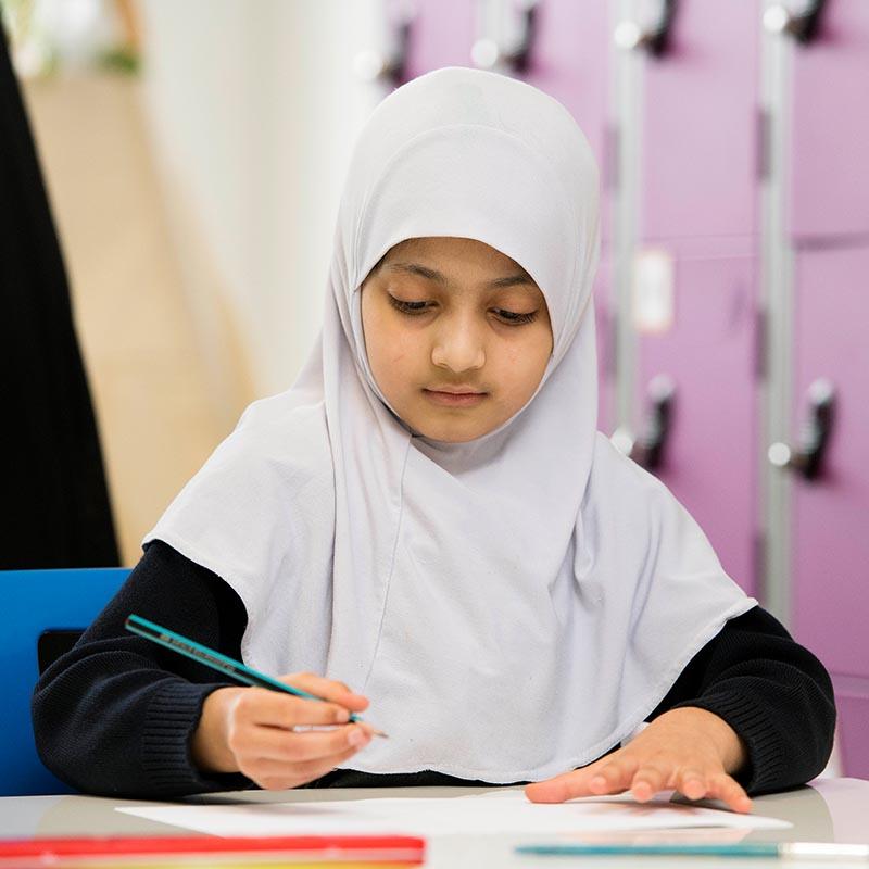 Girl writing in class