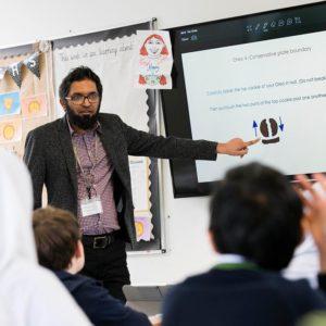 Teacher teaching geography lesson