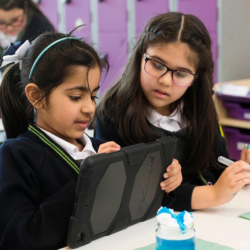 Two girls working on iPad