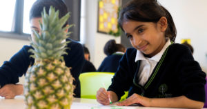 Girl drawing a pineapple
