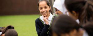 Girl smiling at playtime