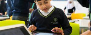 Boy working on iPad