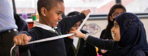 Class measuring boys arm span