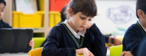 Girl concentrating in class